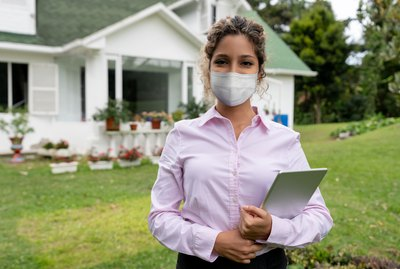 Real estate agent showing a suburb property wearing a facemask