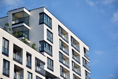 Modern apartment buildings on a sunny day with a blue sky.