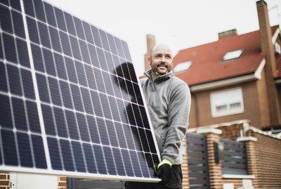 construction worker installing solar panels