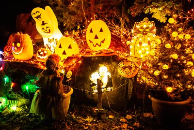 Scary halloween decorations outdoors at night close up