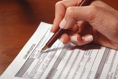 Woman filling in application form, Close-up of hand