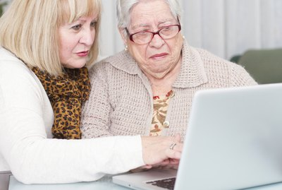 Learning Internet. Daughter teaches her elderly mother using a computer