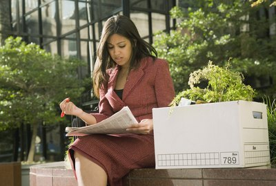 Indian businesswoman reading newspaper