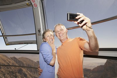 Mature Couple taking pictures while on tram