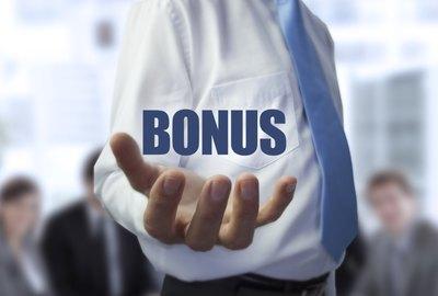 Elegant businessman holding the word bonus