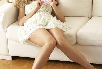 Woman Sitting On Sofa Reading Diary