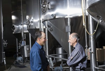 Co-workers talking in a brewery