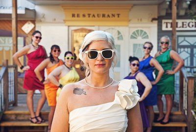 Bride and bridesmaids all wearing sunglasses