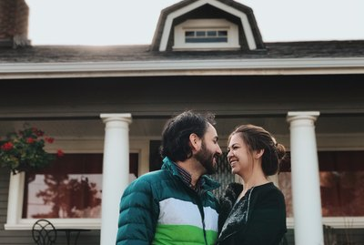 Newlyweds in front of a new house