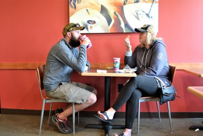 Two people at a coffee shop talking