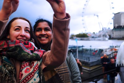 Two women taking a selfie in front of the London Eye