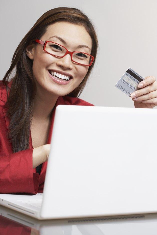 Asian businesswoman shopping online