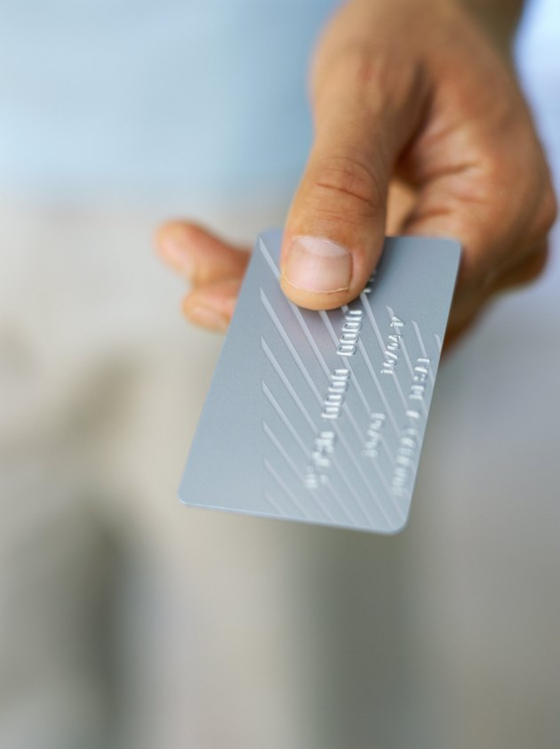 man handing over a credit card for payment
