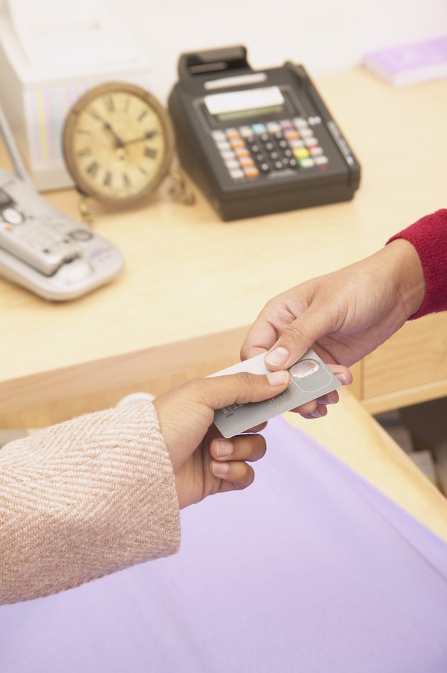 Person making payment with a credit card