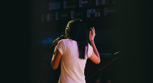 Rear view of woman talking onstage