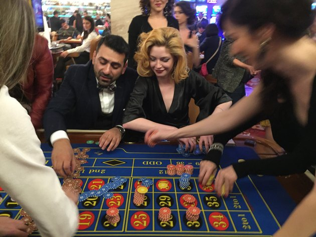Gamblers at a roulette table