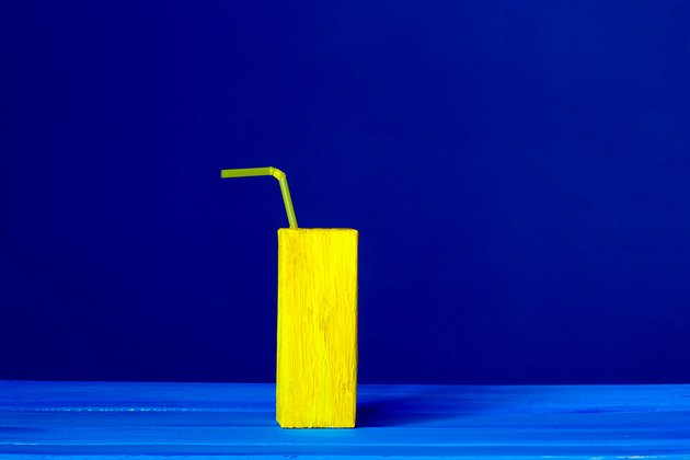 Yellow juice box against blue background