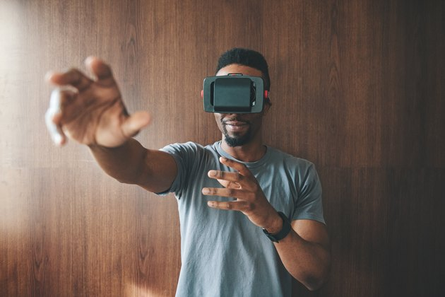 Black man using virtual reality goggles