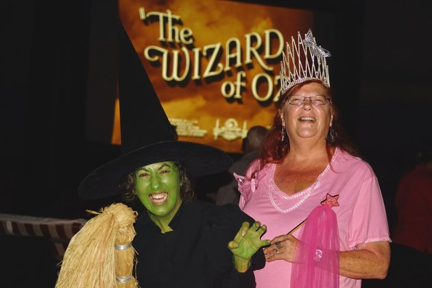Two women dressed as the Wicked Witch of the West and Glinda the Good Witch