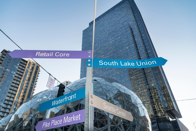 Directional signs at Amazon headquarters showing direction to surrounding neighborhoods in Seattle