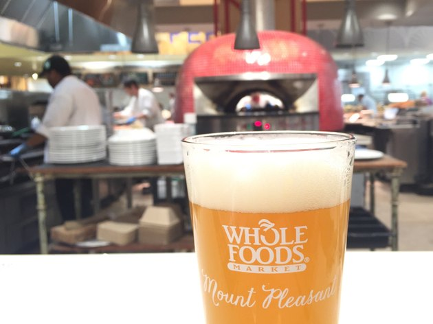 Beer in front of wood-firing oven at Whole Foods