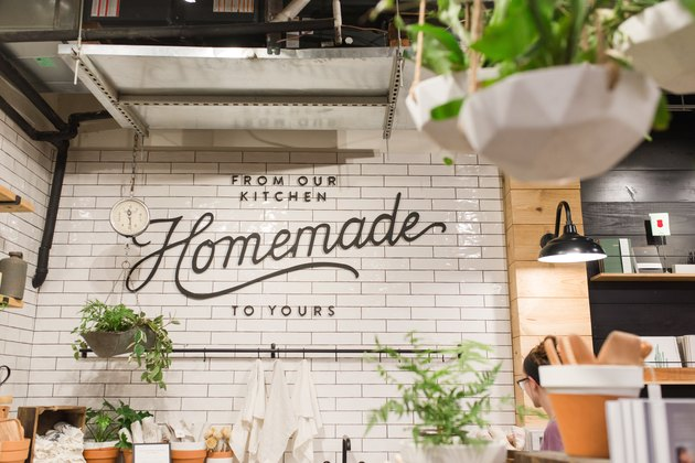 """Hip eatery with word """"homemade"""" on white glazed brick wall"""