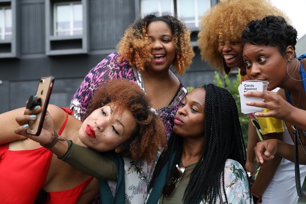 Five young Black women pose for a group selfie