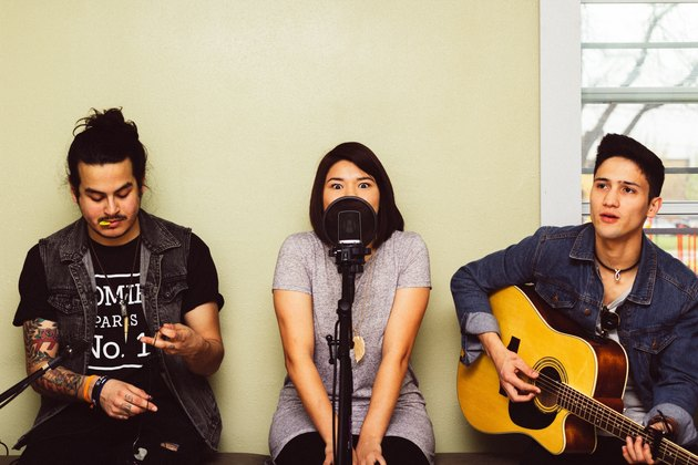Three young people recording a song together