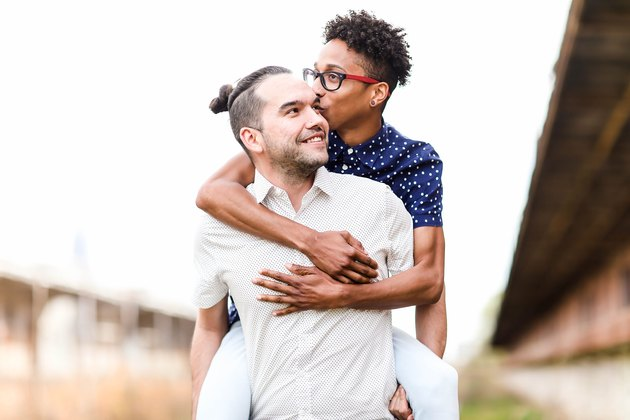 Cute interracial queer couple engagement photo
