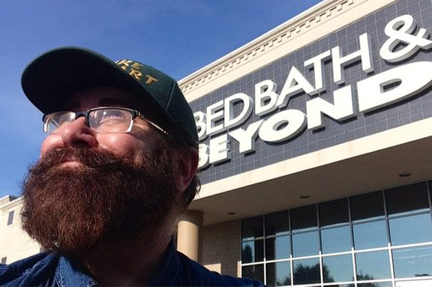 Mike Mozart poses in front of Bed Bath & Beyond storefront