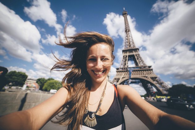White woman's selfie in front of the Eiffel Tower