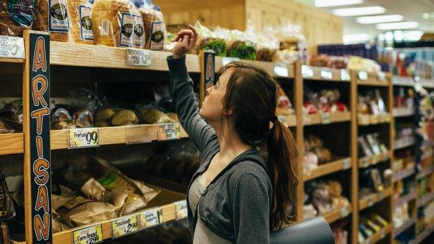 Young woman choosing bread at a Trader Joe's