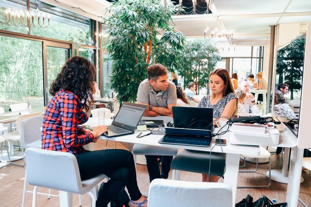 Three employees in an open-place office