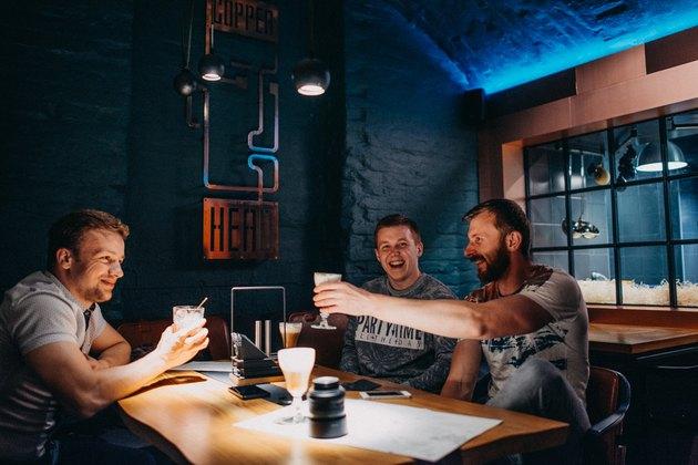 Three men at a hip bar/restaurant