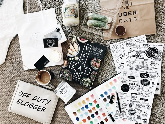 Array of design elements and Uber branded merch