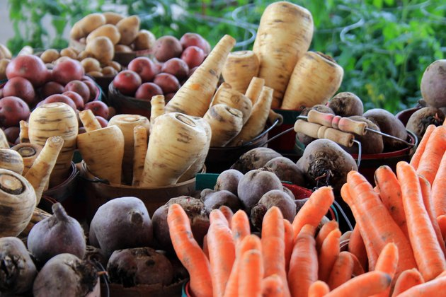 Buckets of root vegetables in produce aisle