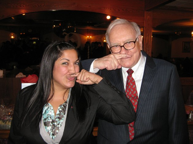 Warren Buffett poses with young business student; both have drawn mustaches on their inner fingers