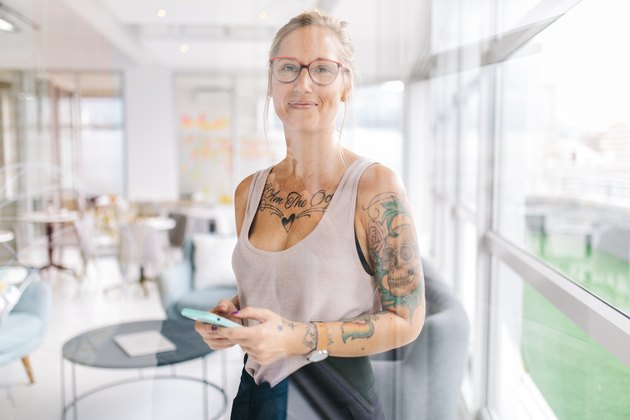 Tattooed woman in modern office setting
