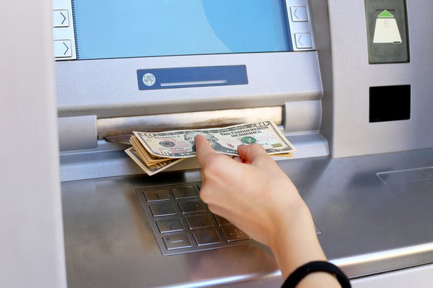 inserting a credit card to ATM