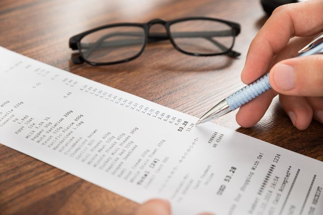 What Are Miscellaneous Expenses?         Businessperson Hands With Receipt And Eyeglasses