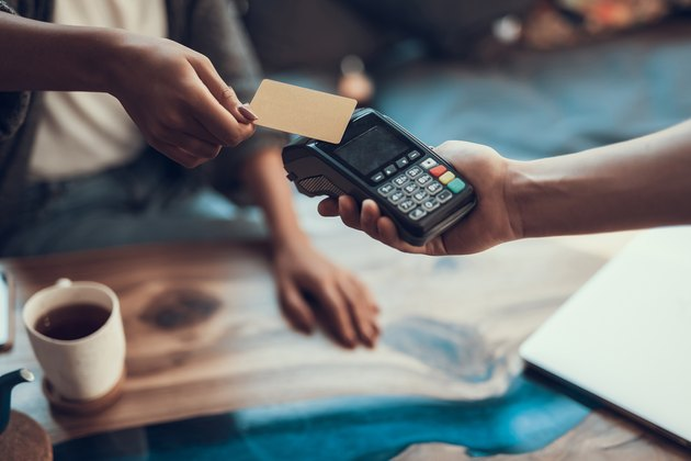 Close up of easy payment by credit card indoors
