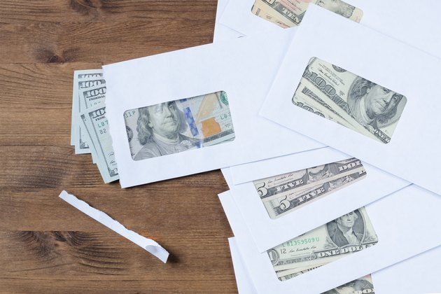 How to Get Electric Bill Payment Assistance          American dollars in envelopes