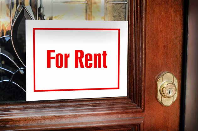 A Standard Lease Agreement for Rental PropertyFor Rent Sign.