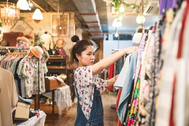 Young woman shopping in a vintage clothing store