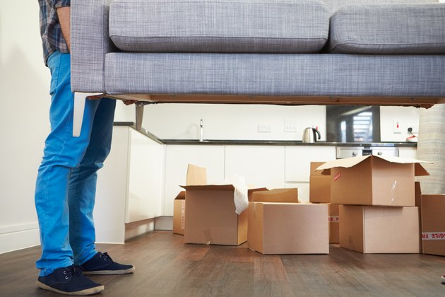 How to Evict a Roommate Not on the Lease in GeorgiaMan Carrying Sofa As He Moves Into New Home