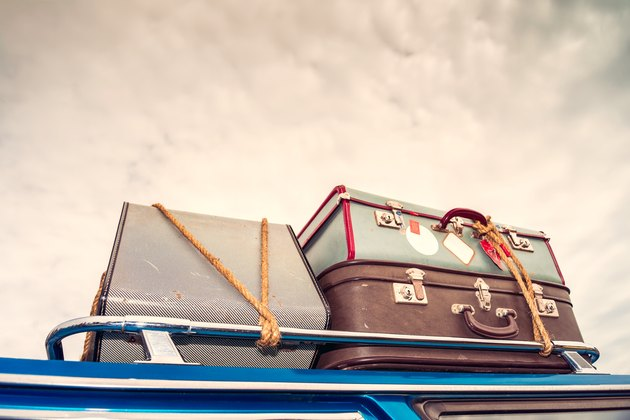 Vintage bags on the car's roof