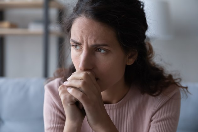 Frustrated stressed young woman thinking of difficult decision.