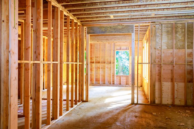 New house under construction framing against