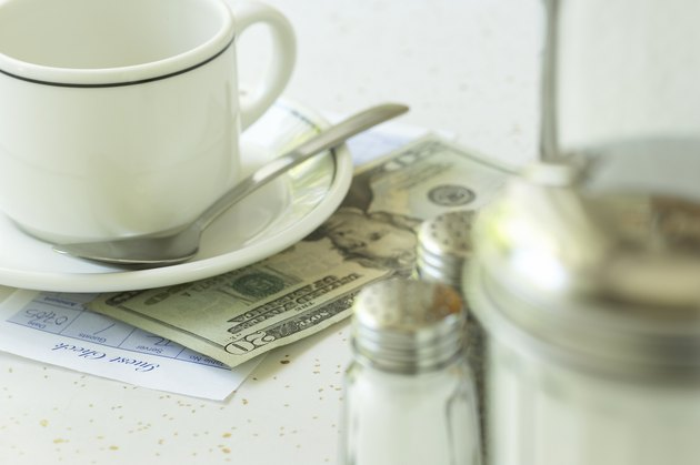 What Is the Tax on Restaurant Food in Illinois? Empty coffee cup and payment