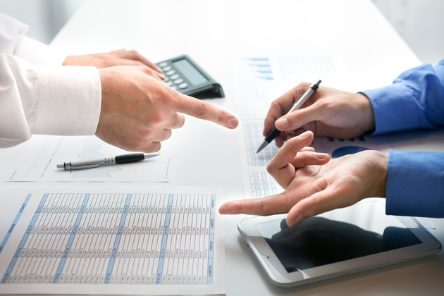 Are Schedule K-1 Partnership Withdrawals & Distributions Taxable Income?Business people at work